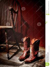 American West Rodeo Cowgirl Boots And Old Chair Stock