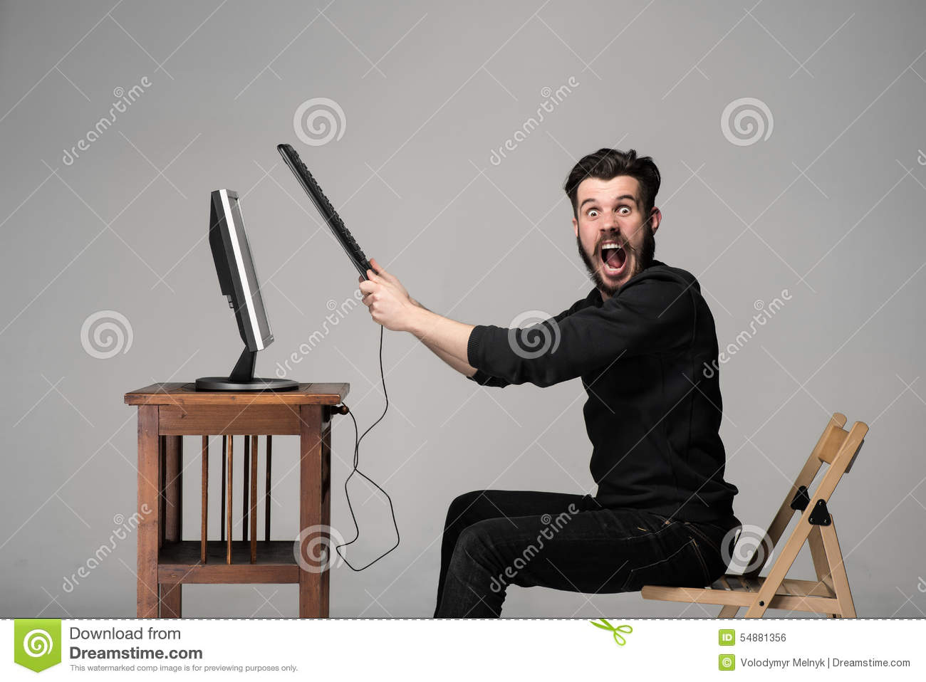 Angry Man Is Destroying A Keyboard Stock Photo  Image