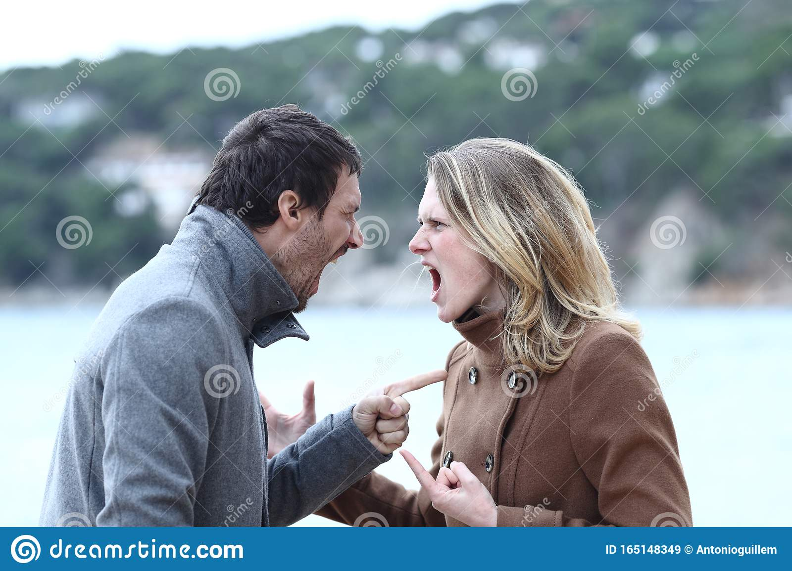 Angry Man And Woman Arguing And Shouting In Winter Stock