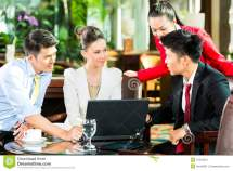 Asian Business People Meeting In Hotel Lobby Stock