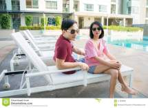 Couple Relaxing Swimming Pool Hotel Stock