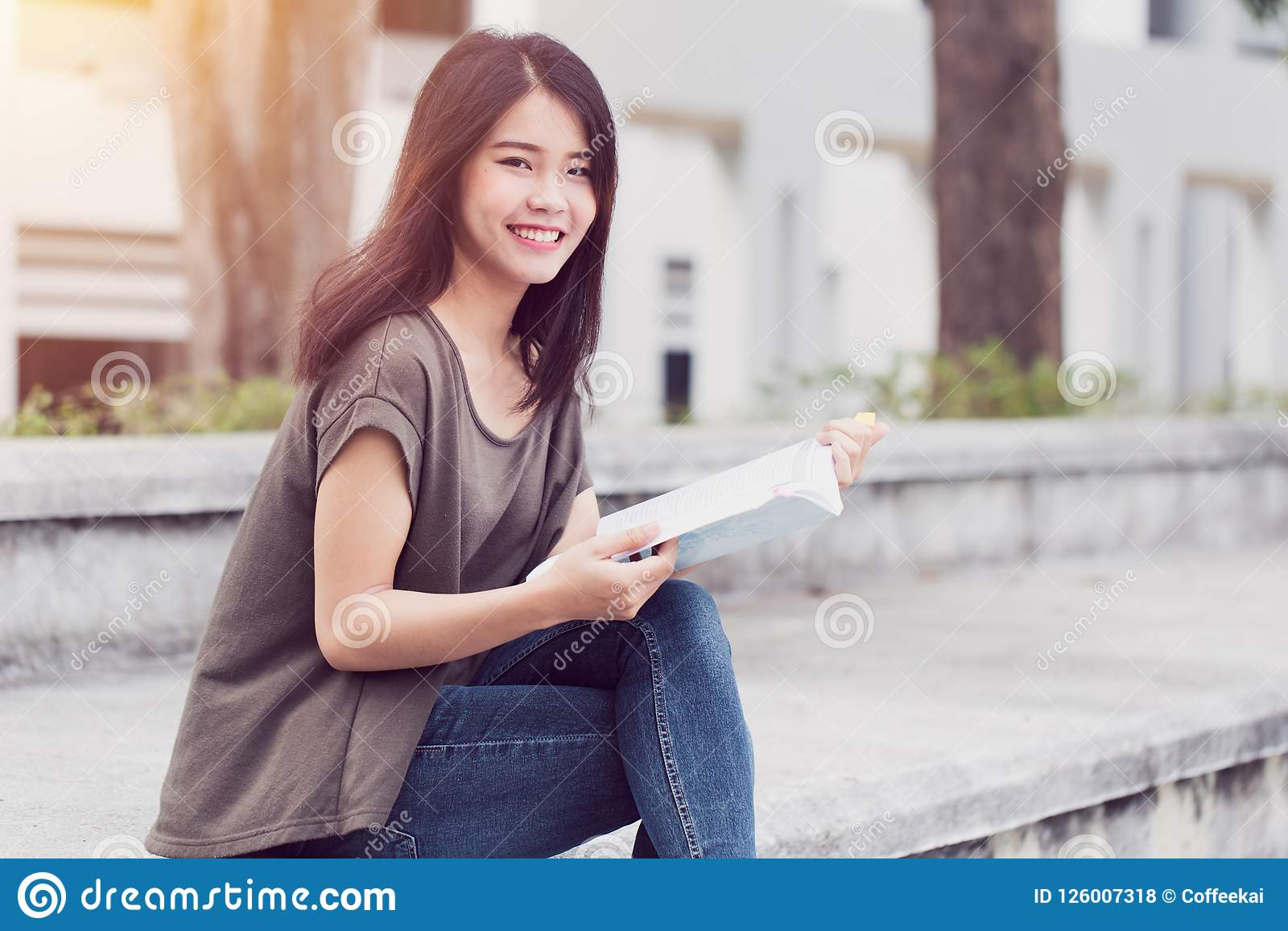 Asian Teen Woman Reading Book Happiness And Smile Enjoy Education In University