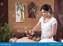 Asian Woman Making Massage Man Stock