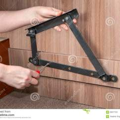 How To Lift A Chair With One Hand Folding Foot Caps Assembling Furniture Hands Screwed Up Bed Adjustable