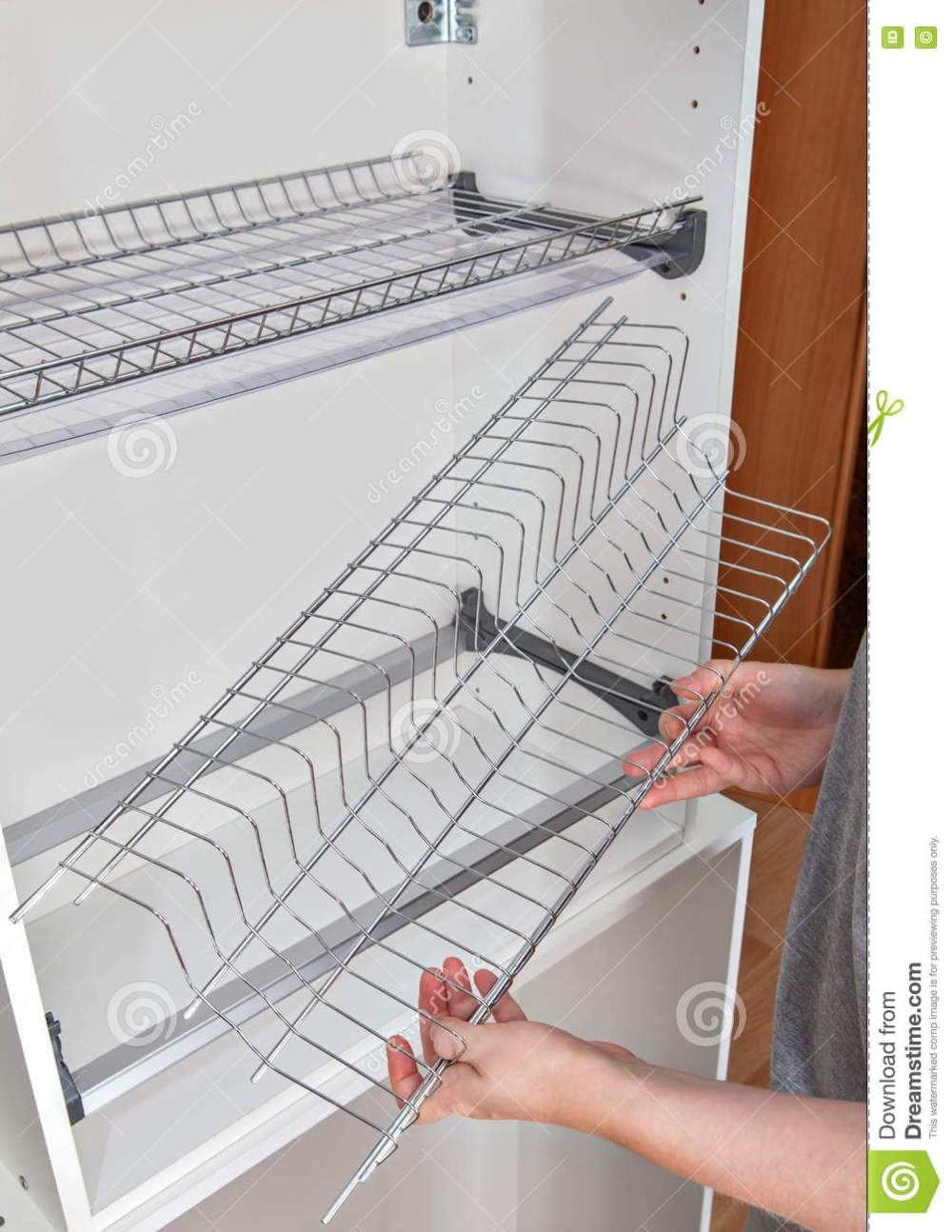 medium resolution of install wall mounted shelf under kitchen cabinet with inside dish rack with drip tray close up of a woman hands holds wire part