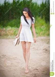 Attractive Brunette Girl With Short White Dress Strolling