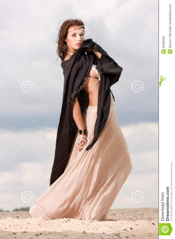 Attractive And Sensuality Woman In Desert Royalty Free Stock - 26588429