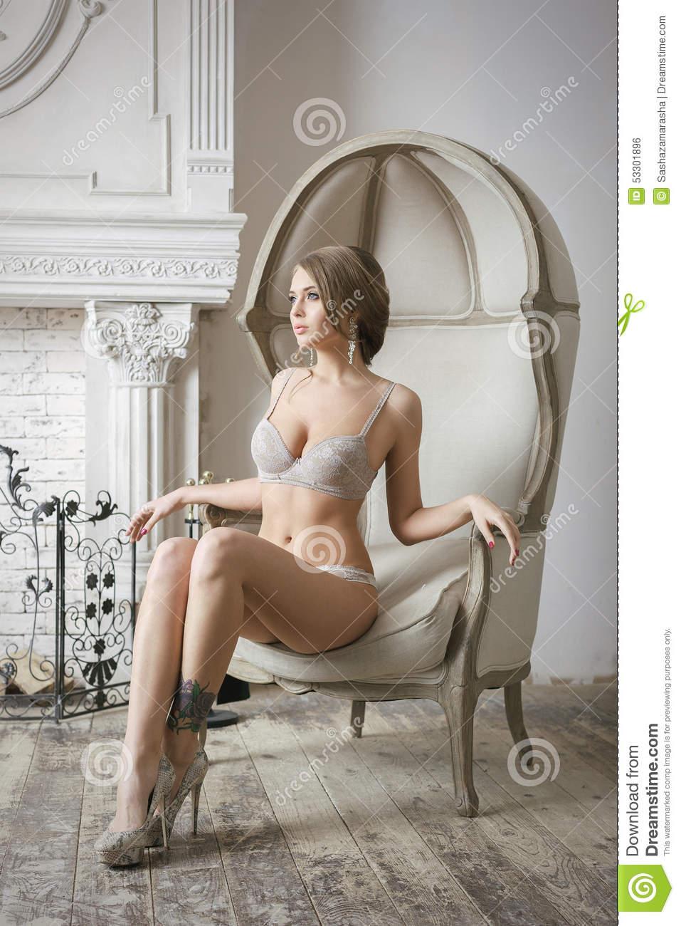 Attractive Blonde Bride Woman Sitting On Chair Stock Photo