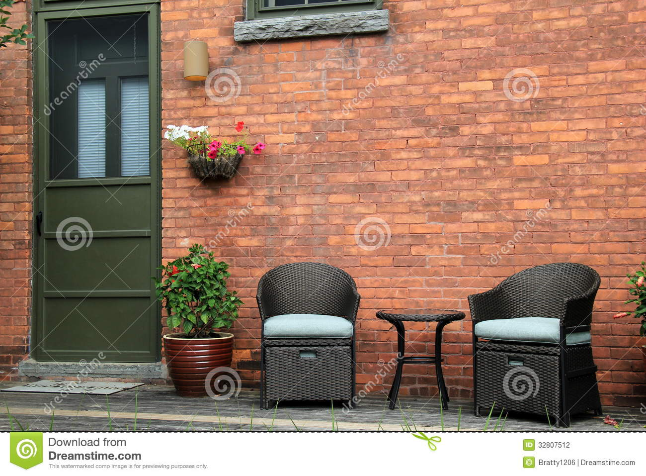 Attractive Wood Porch With Outdoor Furniture Of Old Brick