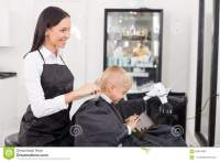 Attractive Young Female Hairdresser Is Doing Stock Photo ...