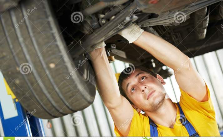 Auto Mechanic At Car Suspension Repair Work Stock Image Image 26902511