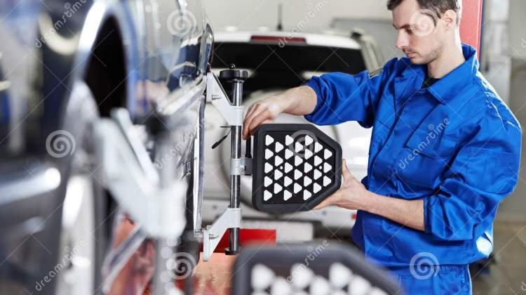 Auto Mechanic At Wheel Alignment Work With Sensor Stock Image Image Of Scheduled Failure