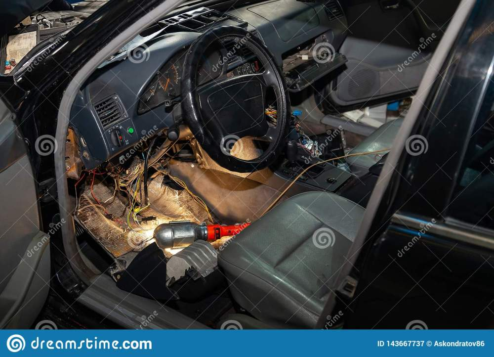 medium resolution of automotive wiring under the wheel of an old german car a disassembled dashboard for repairing