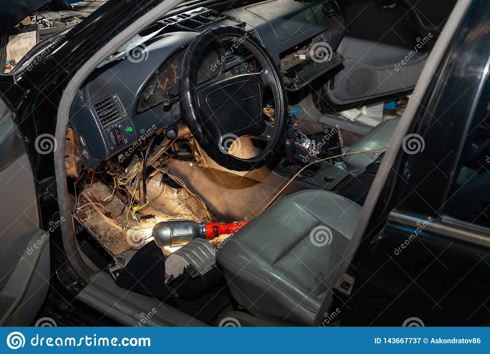hight resolution of automotive wiring under the wheel of an old german car a disassembled dashboard for repairing