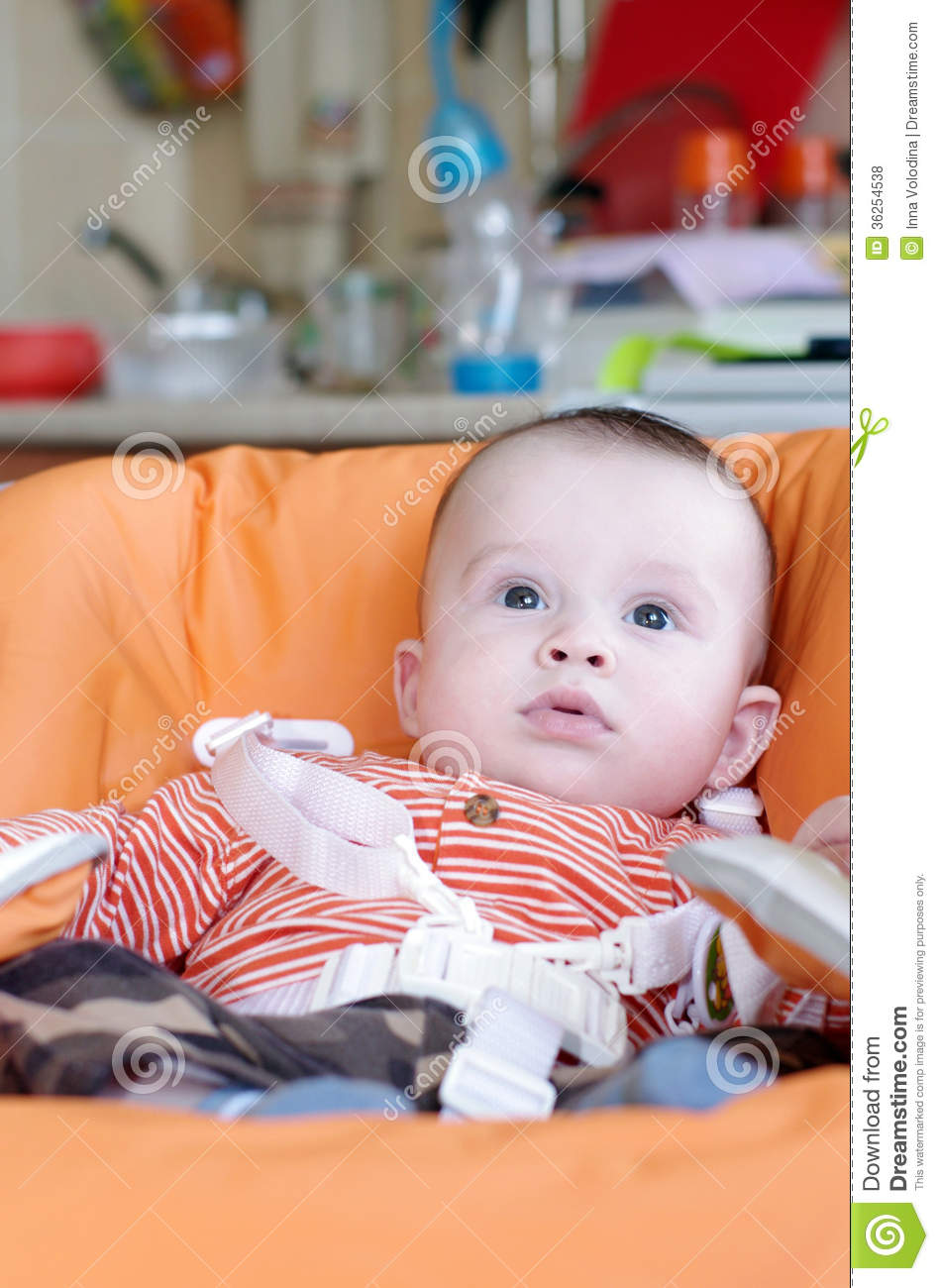 age for high chair black spandex covers sale baby of 5 months sitting on highchair stock photo image