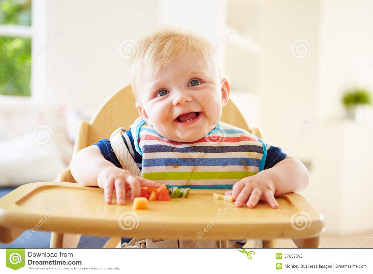 High Chair For Baby Boy Baby Boy Eating Fruit In High Chair Royalty Free Stock