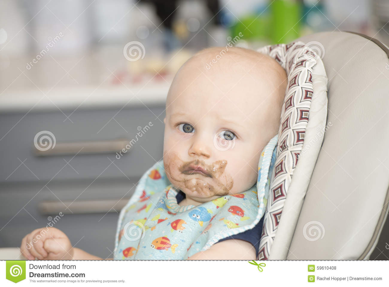 Baby Food Chair Baby Boy With Food On His Face In A High Chair Stock Photo