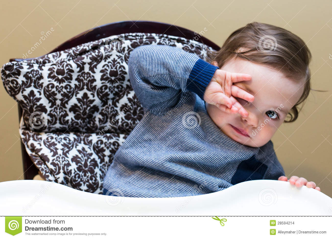 High Chair For Baby Boy Baby Boy In High Chair Hiding Behind His Hand Stock Images