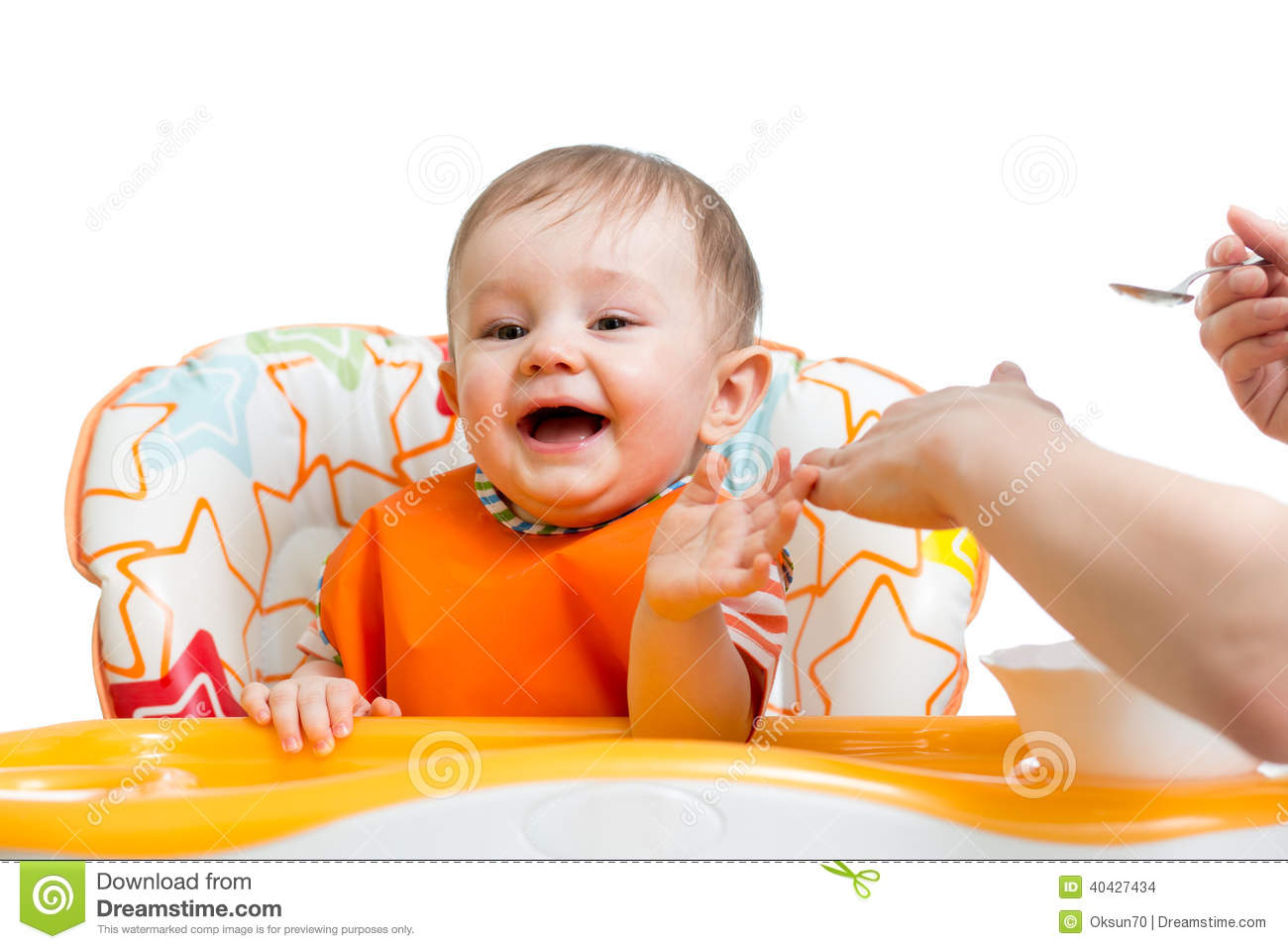 High Chair For Baby Boy Baby Boy Sitting In High Chair And Eating With A Spoon