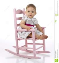 Baby Girl In Rocking Chair Stock Photo - Image: 16169050