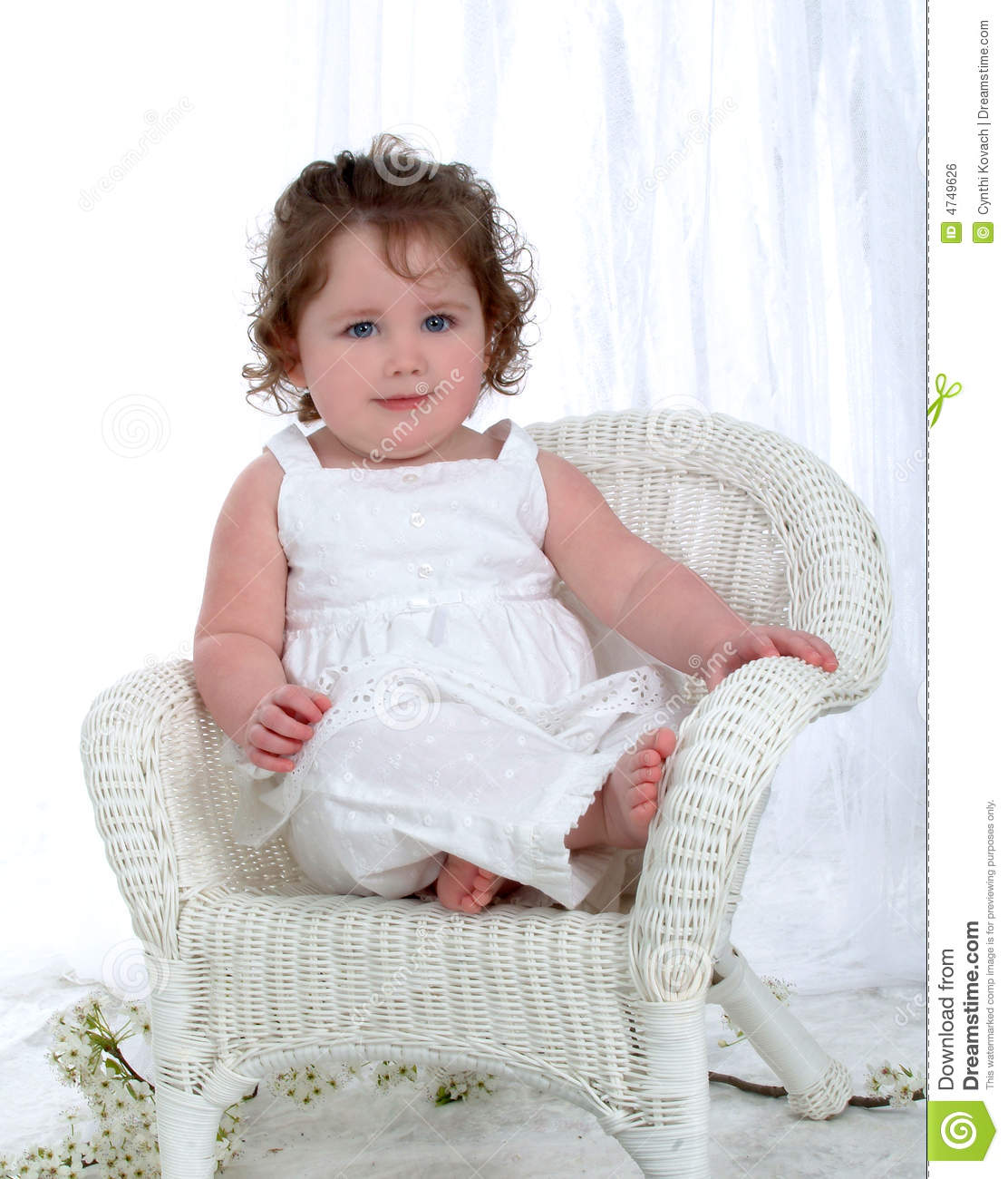 baby bamboo chair swivel replacement cushions girl on wicker royalty free stock image
