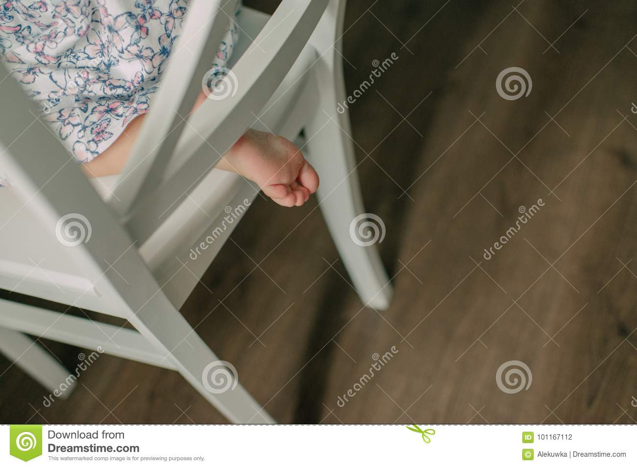 revolving chair for baby large living room with ottoman leg peeking stock photo image of toes foot table 101167112 under a vintage