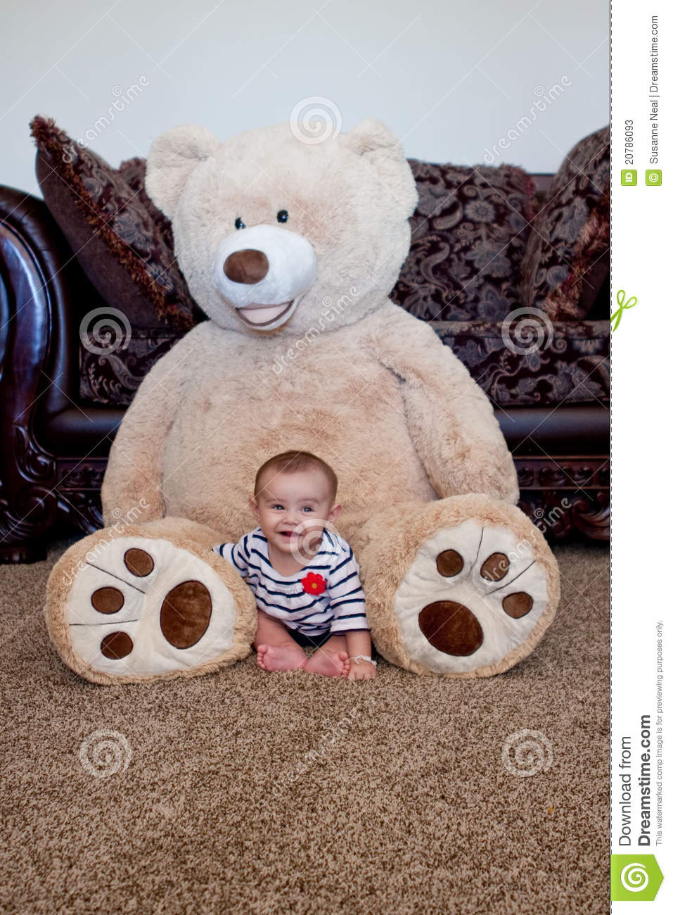 Baby Sitting In Front Of Giant Teddy Bear Stock Image