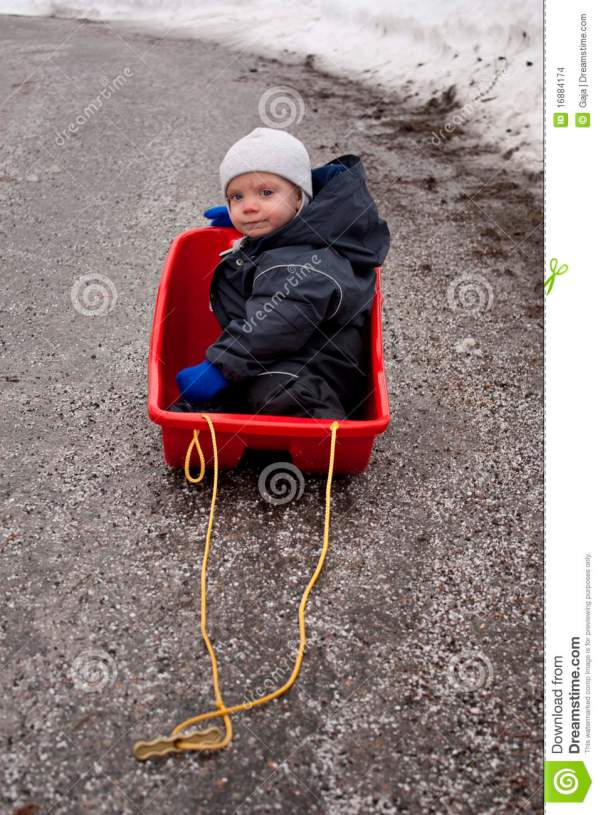 Baby In Sled Stock Of Long Melting Dirty - 16884174