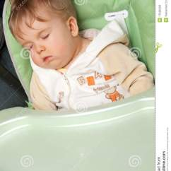 Baby Sleeping Chair Office Herman Miller Sleep On Feeding Stock Photo Image Of Rests Relax