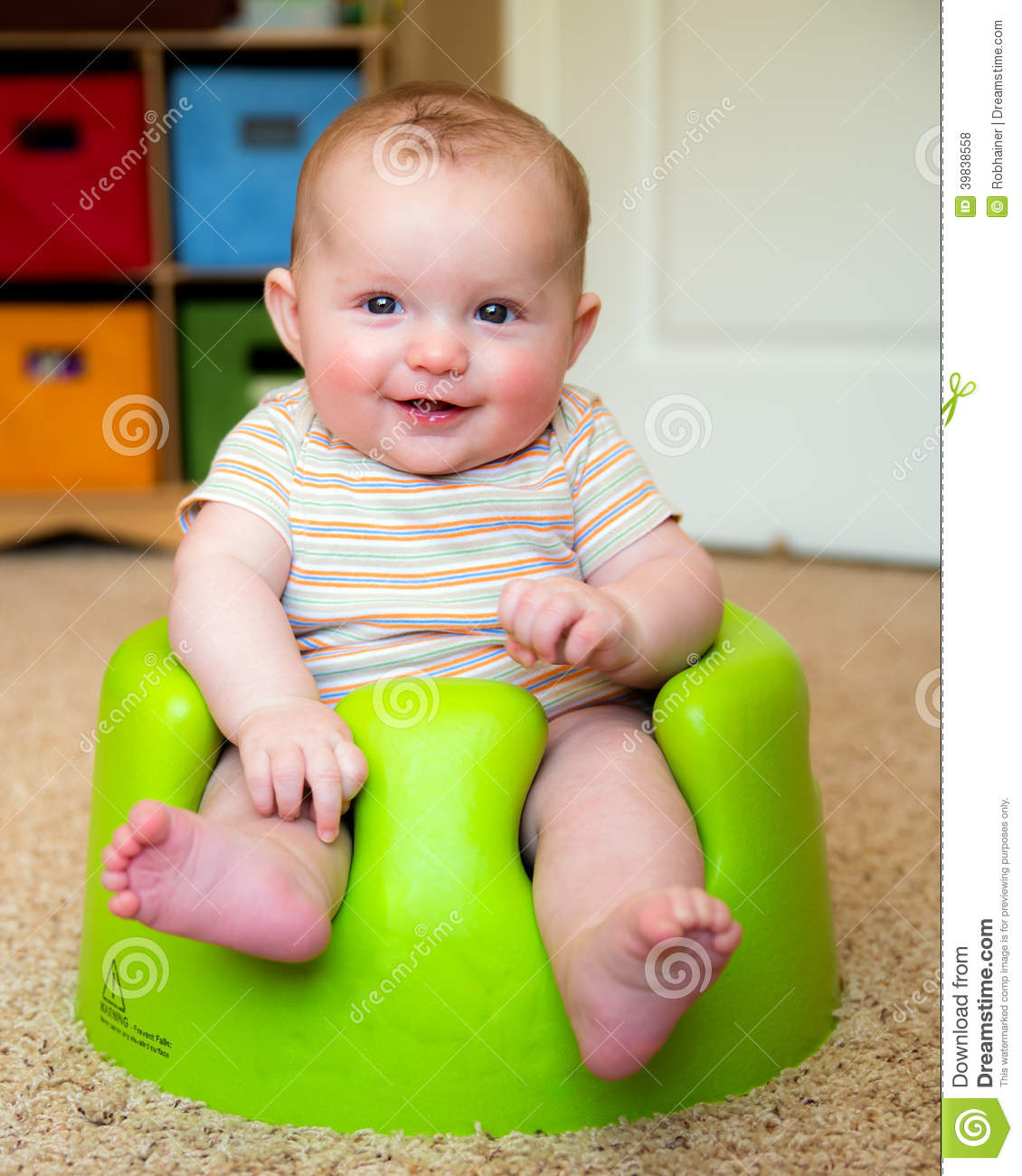 Baby Using Training Bumbo Seat To Sit Up Stock Photo