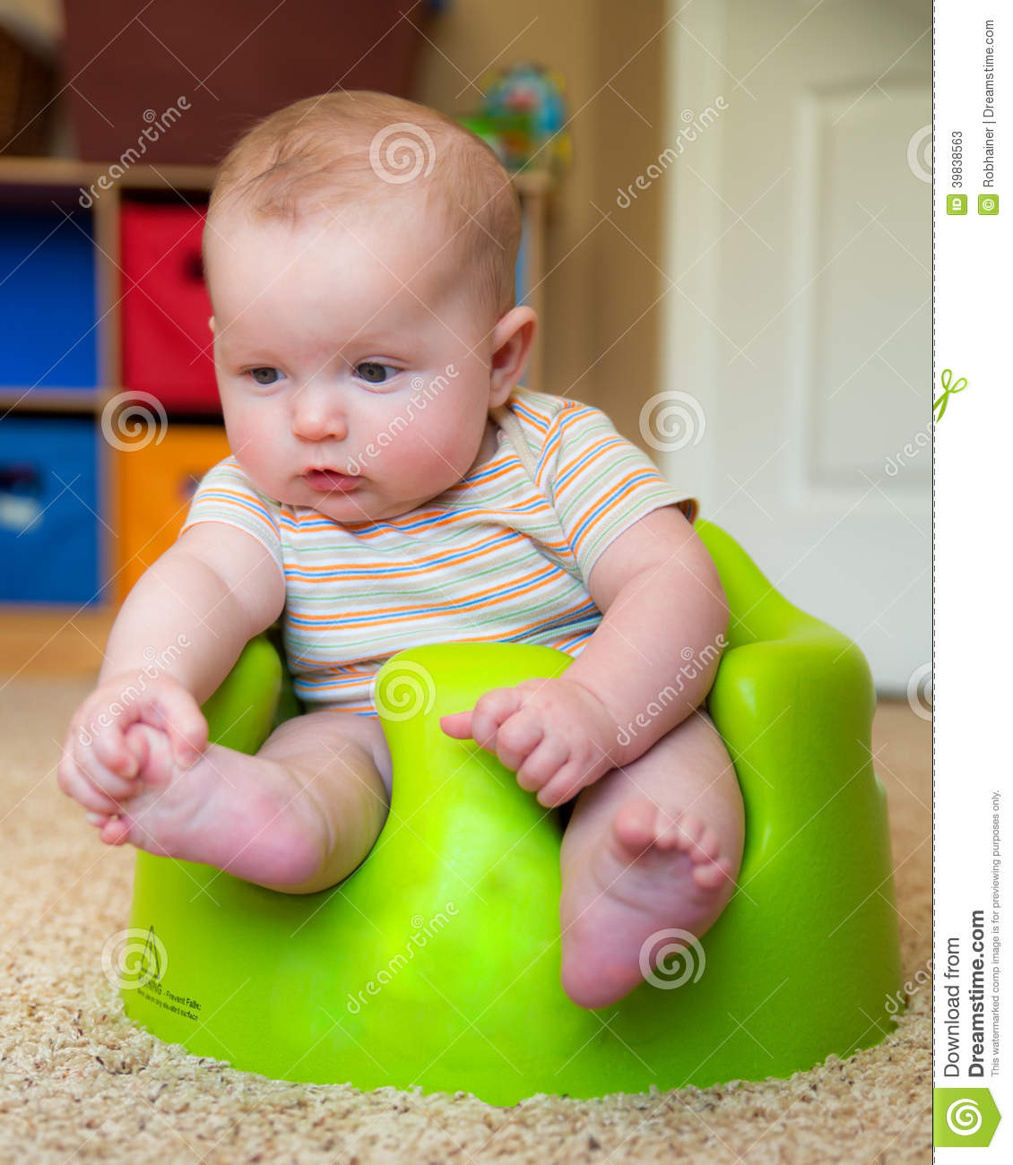 Baby Using Training Bumbo Seat To Sit Up Stock Image