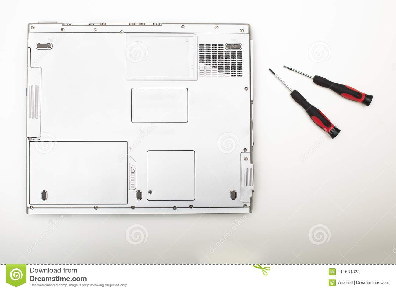 hight resolution of back side of a modern laptop computer with precision screwdriver