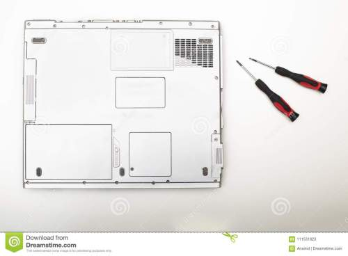 small resolution of back side of a modern laptop computer with precision screwdriver