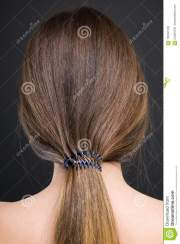 view of young woman with ponytail