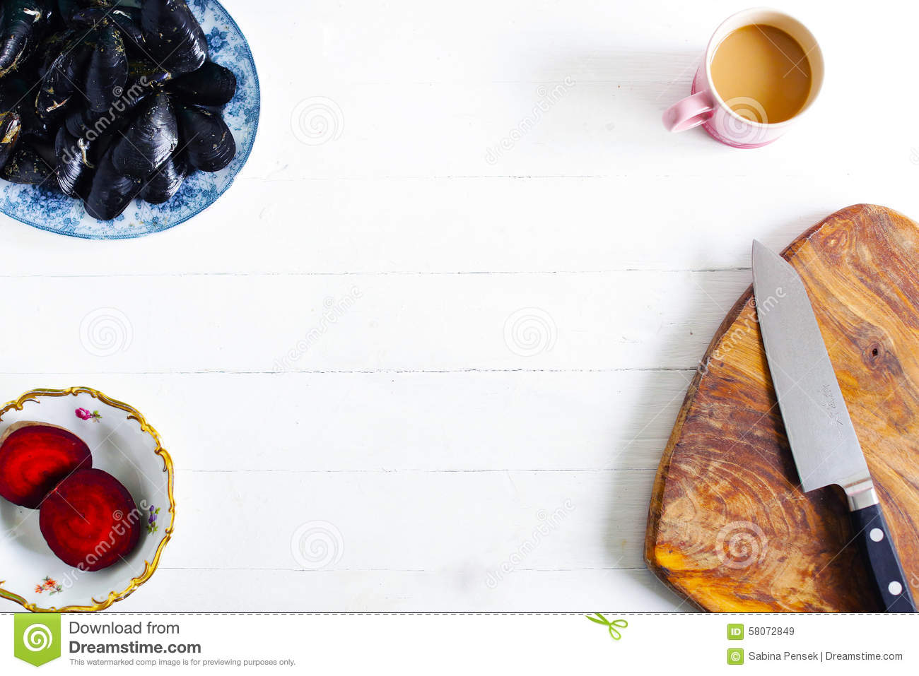 kitchen food preparation table lantern lights over island background mussels beet coffee