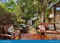 Backyard Cozy Patio Area With Wicker Furniture Set Royalty ...