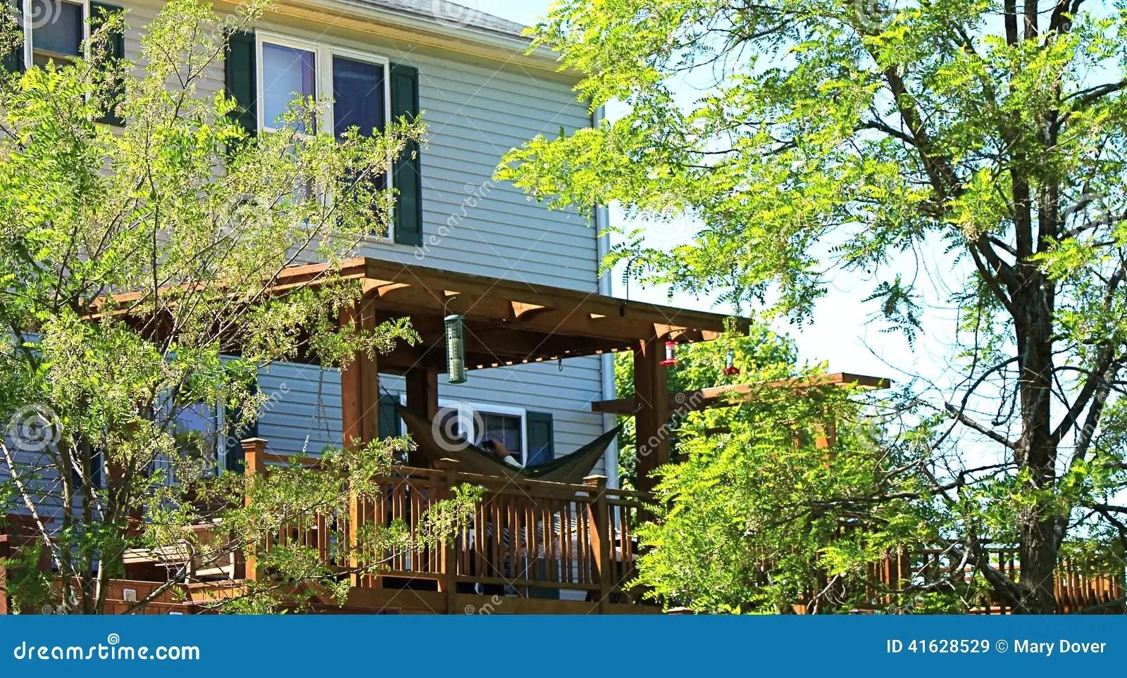 Backyard Deck With Hammock Under Pergola Stock Photo