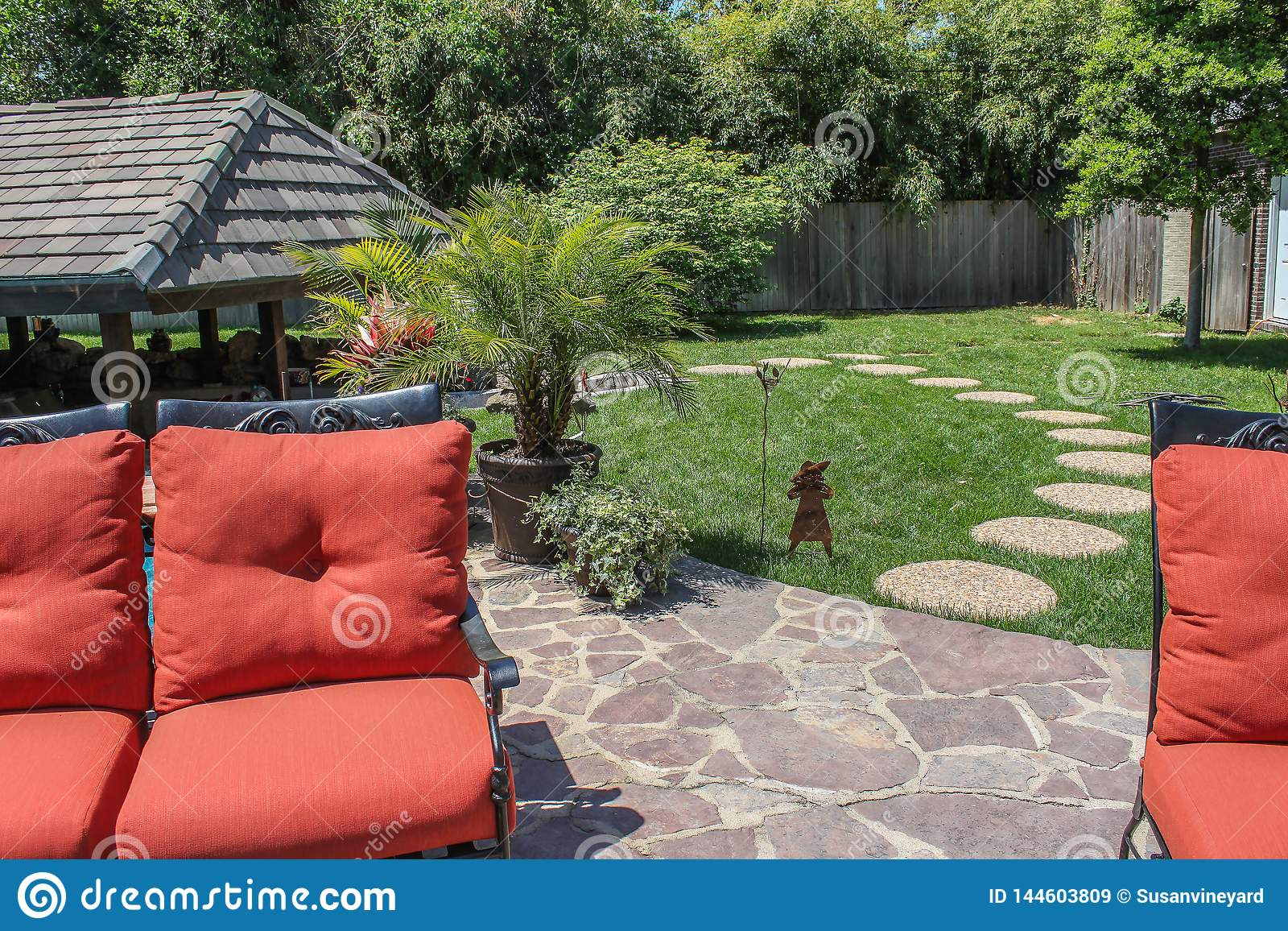 https www dreamstime com backyard garden patio stepping stones to covered outdoor living area orange cushioned lawn furniture foreground wooden image144603809