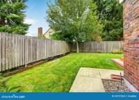 Backyard With Wooden Fence And Walkway Stock Photo - Image ...