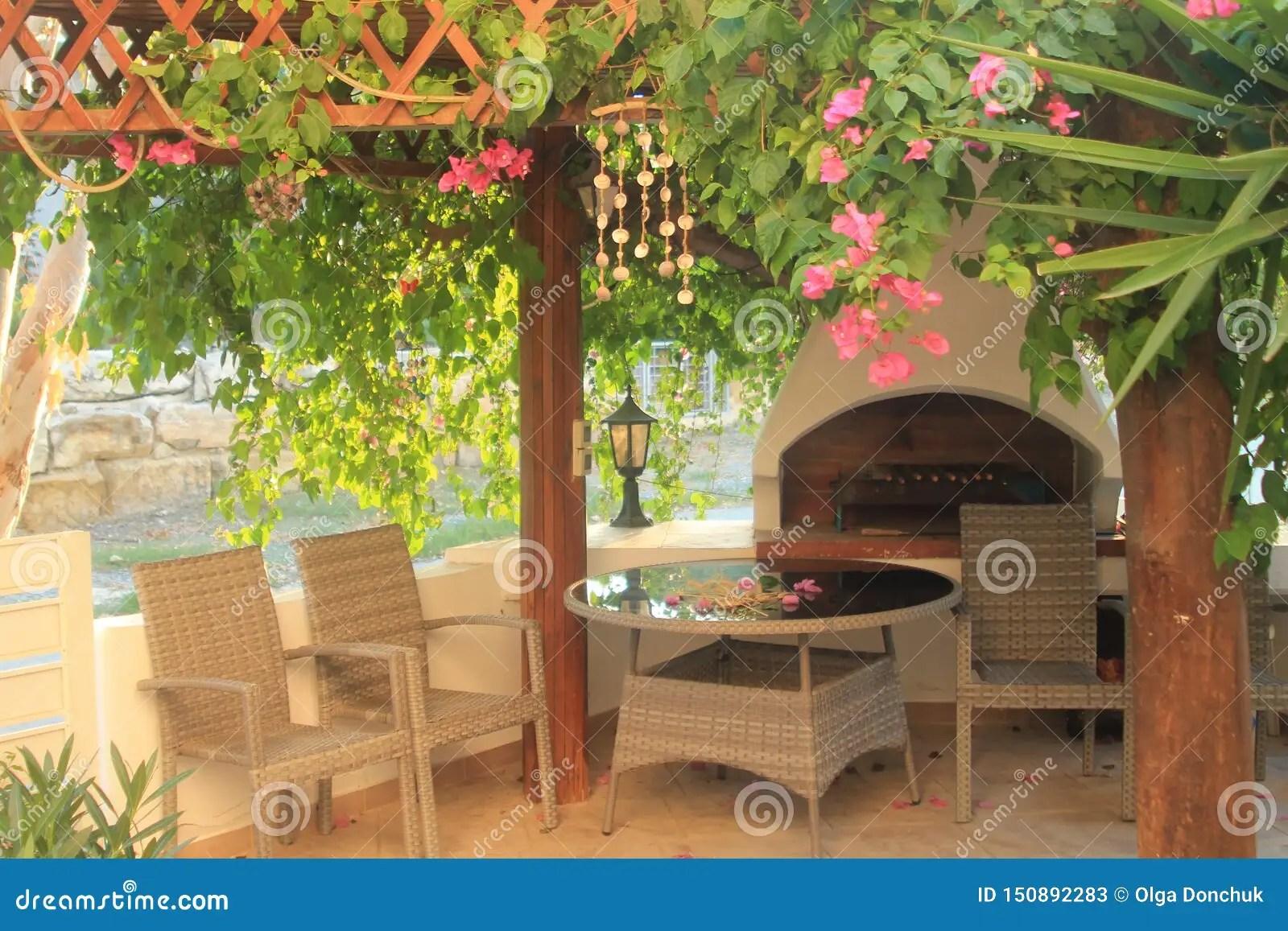 https www dreamstime com barbeque gazebo garden barbeque gazebo grill patio furniture set green leaves pink flowers image150892283