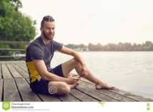 Barefoot Bearded Young Man Relaxing Deck Stock