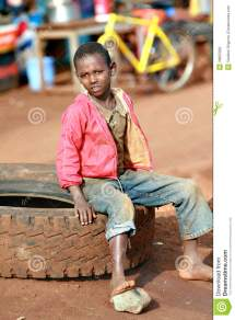 Barefoot Black Boy Resting Sitting Car Tire Editorial