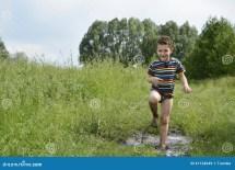 Dirty Barefoot Boy Running