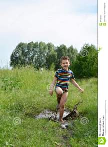 Dirty Barefoot Boy Running