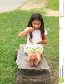 Barefoot Girl Eating Stock Of Bare Grass