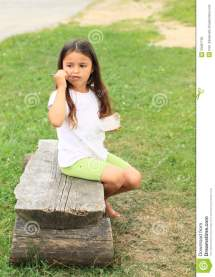 Little Girl Sitting Barefoot