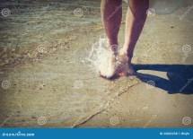 Girl Walking Barefoot in Water