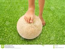 Barefoot Kid Playing Football Stock - 64844601
