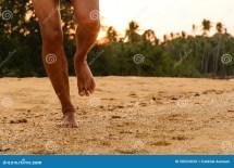 Barefoot Running On Beach