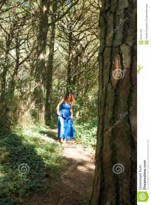 Barefoot Woman Dressed In Blue Walking